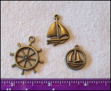 Steampunk Trinkets - Nautical Theme for Art Dolls - Bronze sailboat, ship's wheel,& rope circle sailboat