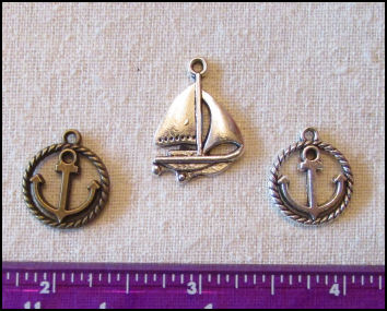 Steampunk Trinkets - Nautical Theme for Art Dolls - Silver Sailboat, silver ripe circle anchor, & bronze rope circle anchor