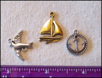 Steampunk Trinkets - Nautical Theme for Art Dolls -  Gold sailboat, silver rope circle sailboat, and silver bird/seagull