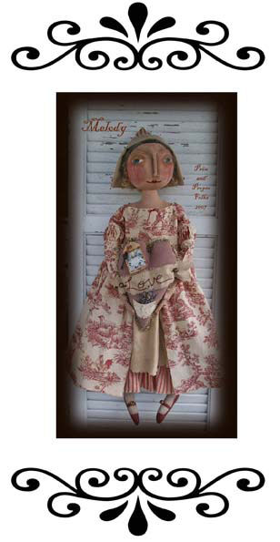 "Red and cream toile fabrics make a perfect costume for this romantic 23"" doll with painted and needlesculpted features."