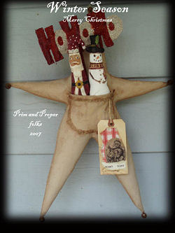 "This versatile 16"" primitive star has a pocket that holds a wonderful variety of seasonal figures that are included in the pattern."
