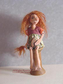 "This lovely 13"" seated troll girl is made of bucksuede with beaded joints and has opposable thumbs."