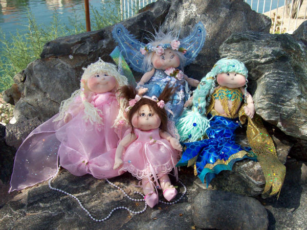 "Incredibly versatile pattern with 4 different eye styles, 4 different hair styles and four wonderful costumes – a Fairy Sprite, Ballerina, Mermaid and Princess for this delightful 10"" doll.   Mix and match to your hearts content.  !/2 yard of craft velour will make 4 doll bodies."